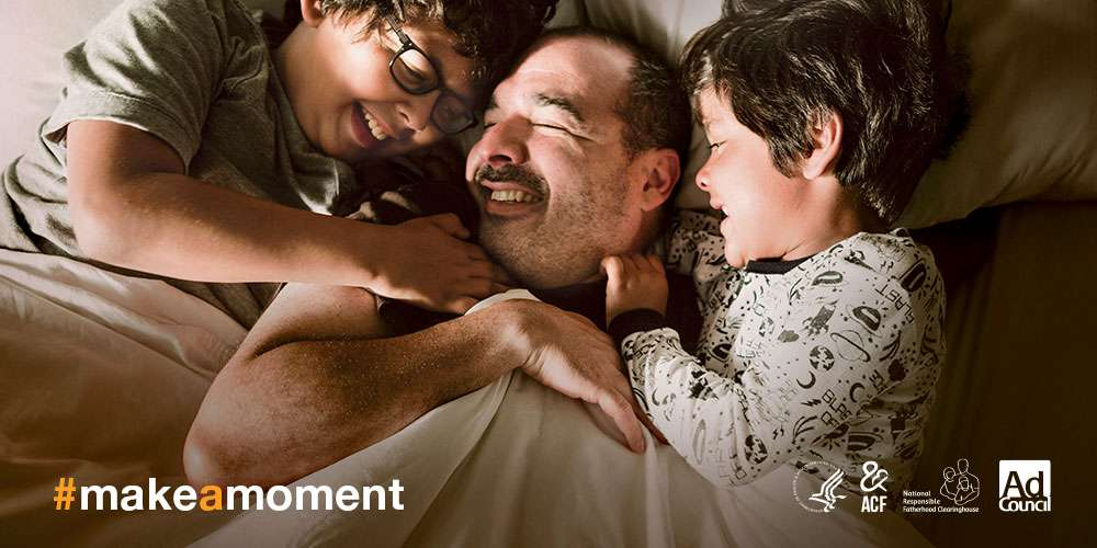 Father and two sons laughing in bed #makeamoment logos Department of Health and Human Services Administration for Children and Families National Responsible Fatherhood Clearinghouse Ad Council